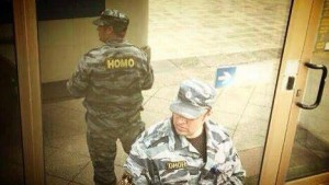 Russian OMOH policeman reflected showing HOMO